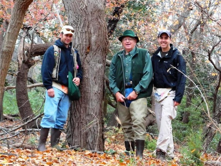 Standing with my co-worker Jim Sparks (left) and our boss and friend Ray Dueser (center) next to a large Sassafras tree on Fisherman's Island.